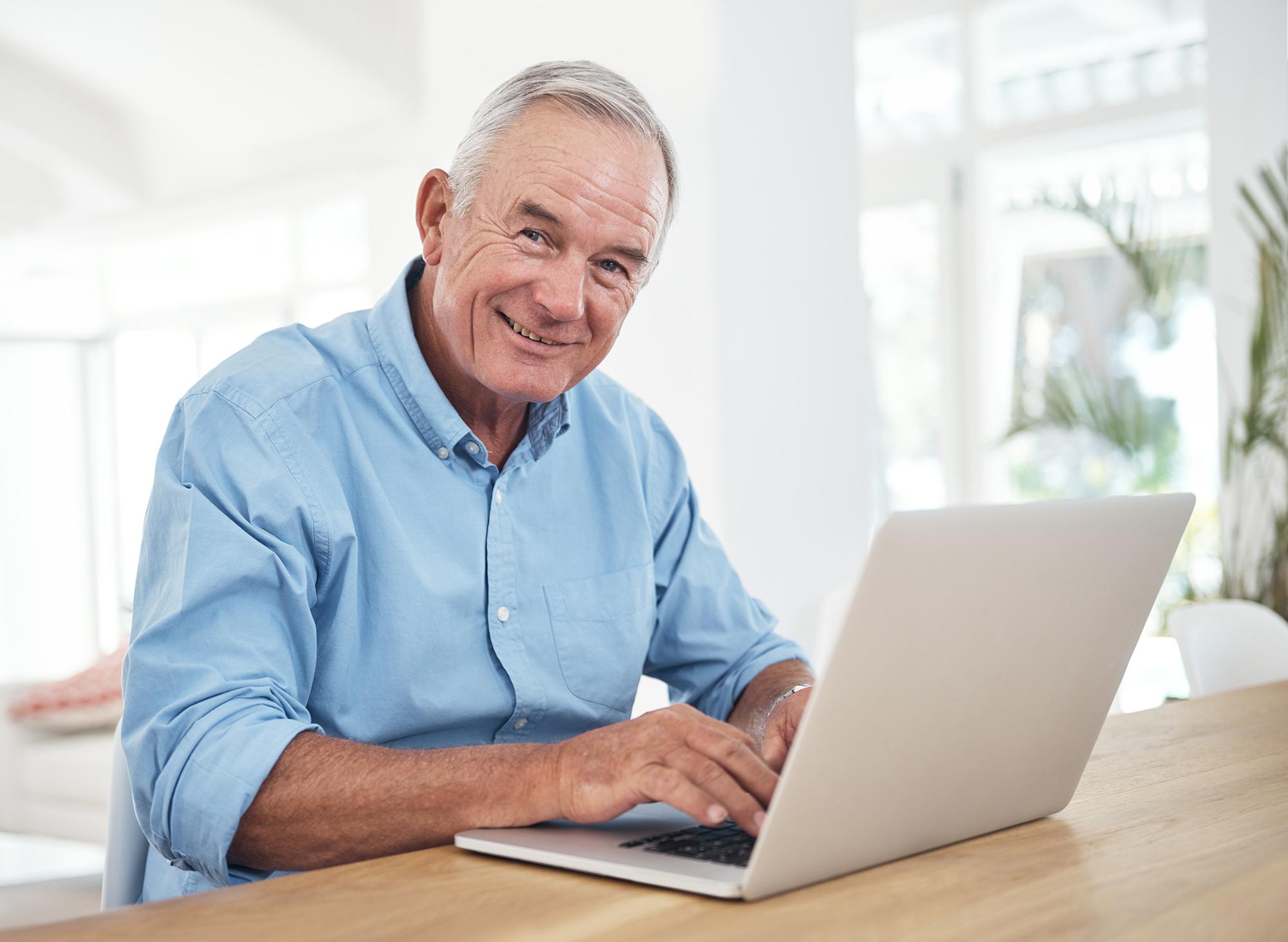 older man on a laptop