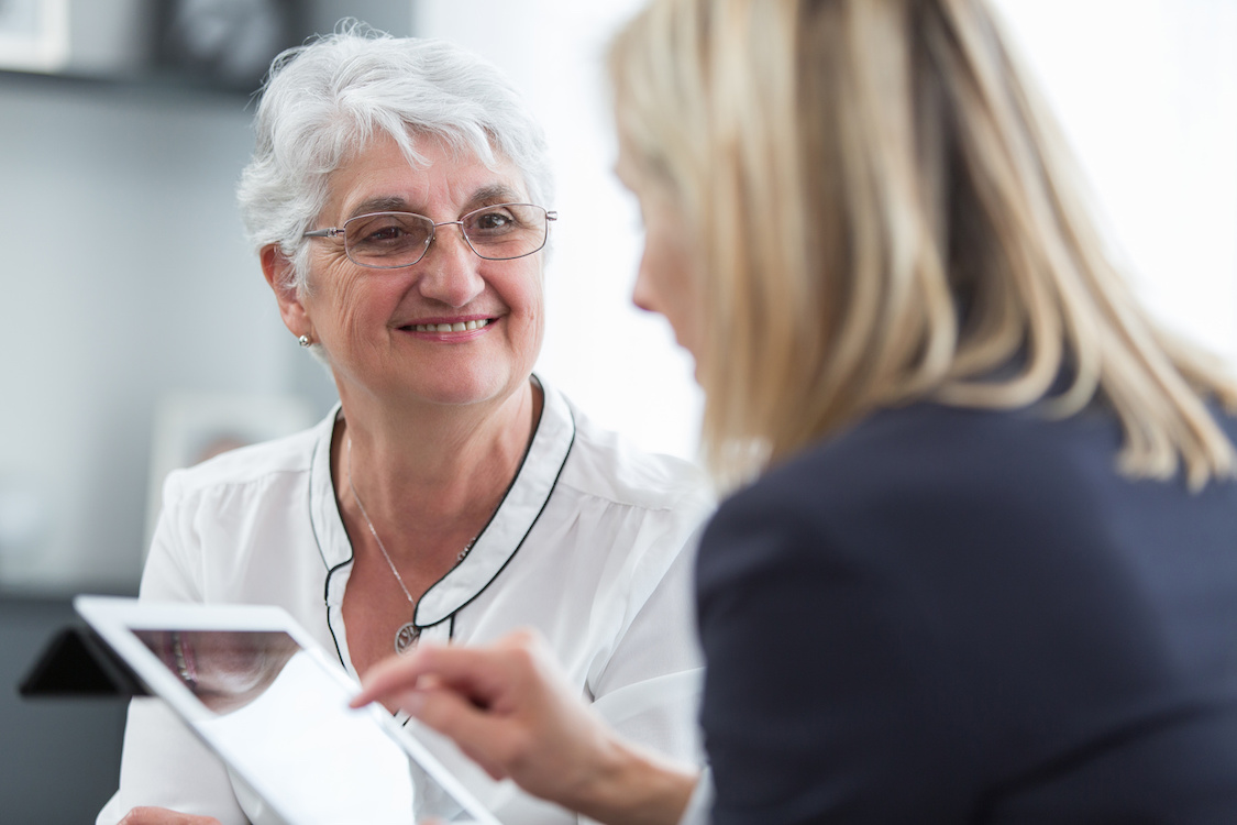 older woman with heath professional