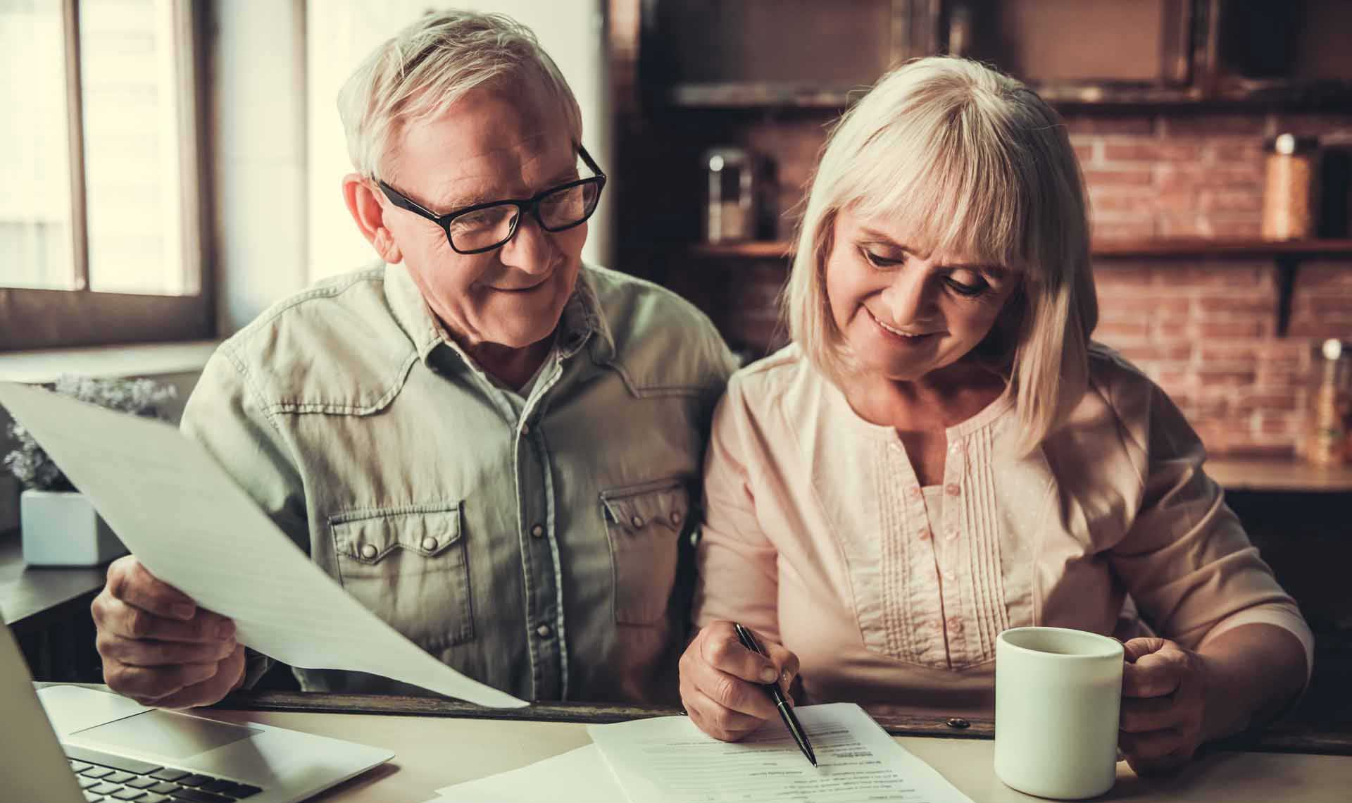 Elderly couple filling out forms