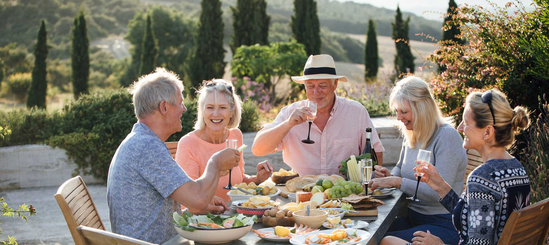 A family having lunch outdoors at a winery
