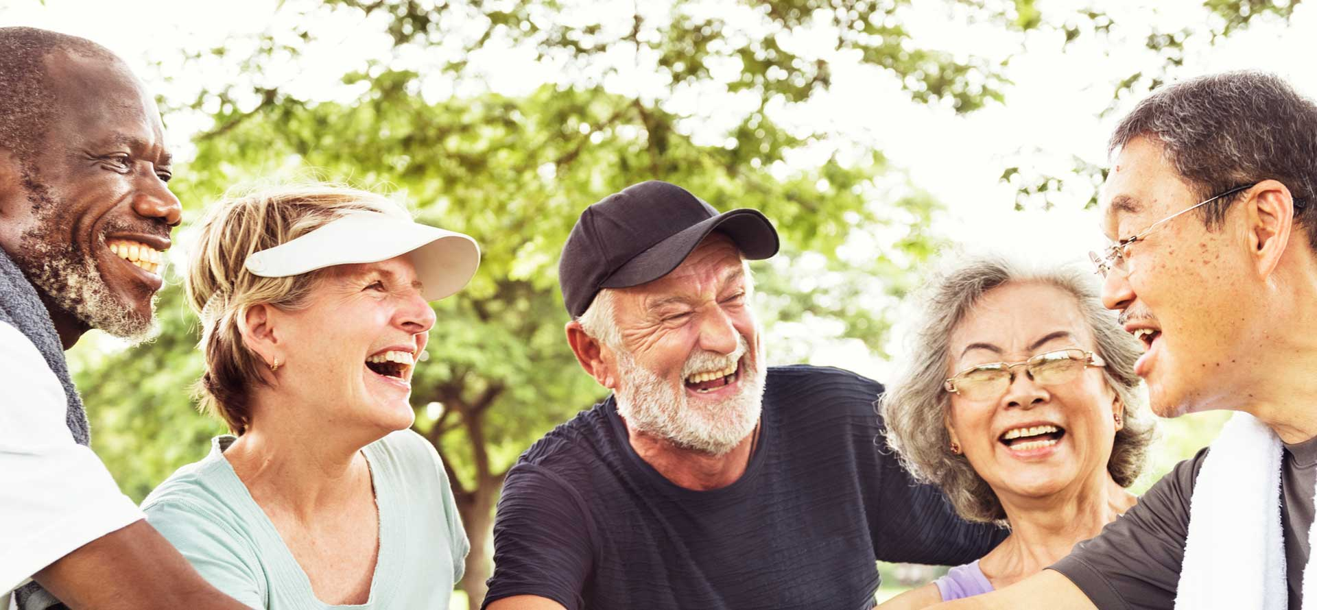 elderly sports group of friends holding hands and laughing