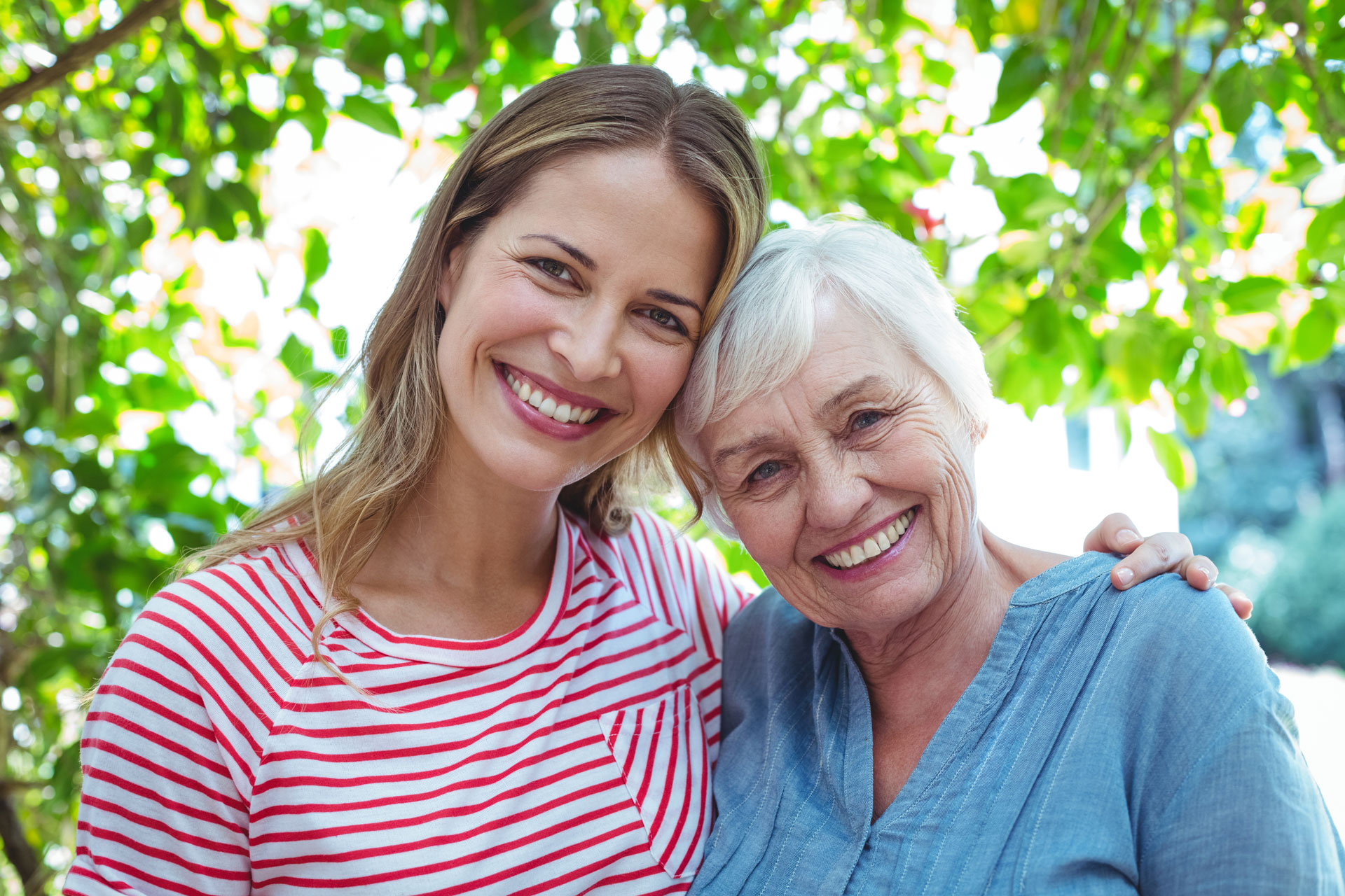 Senior mother and daughter smiling