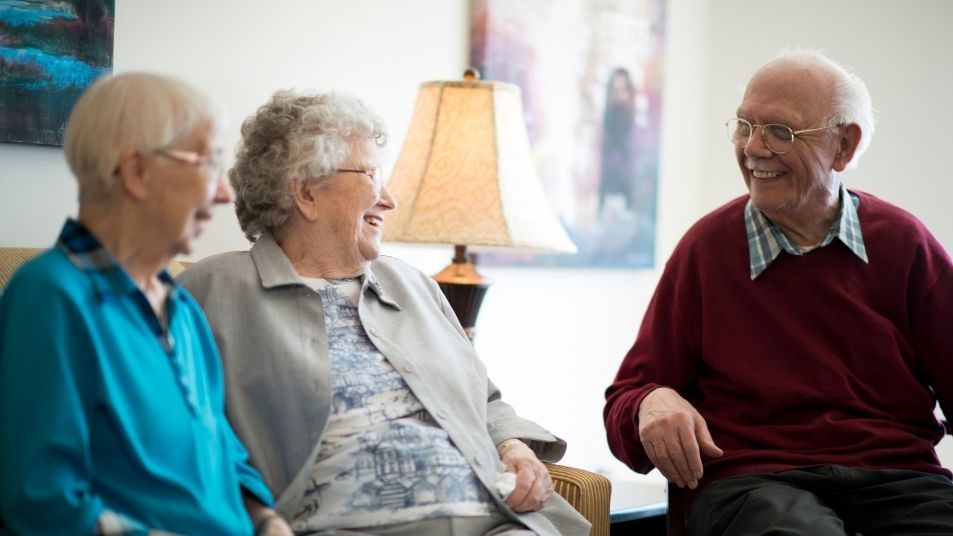 residents in aged care sitting and talking