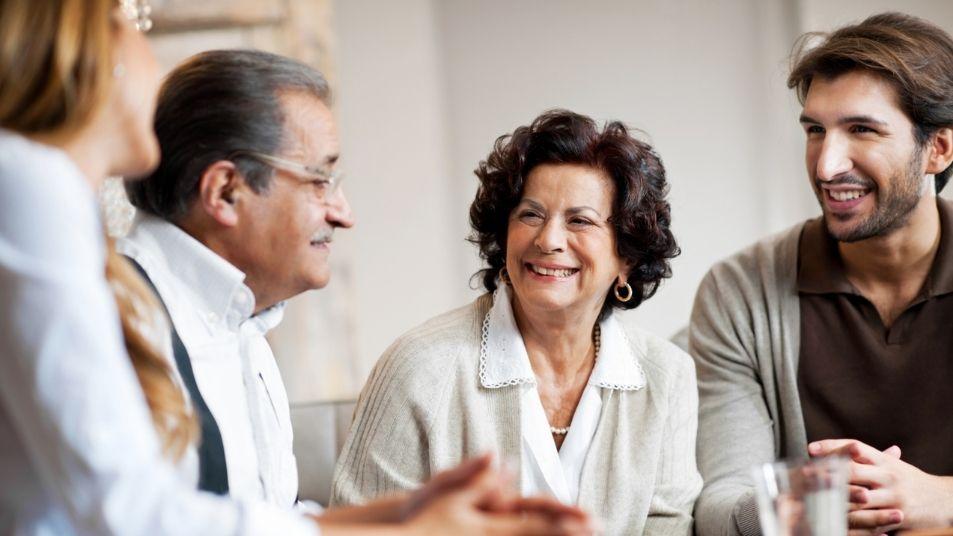 multi generational family having a positive conversation