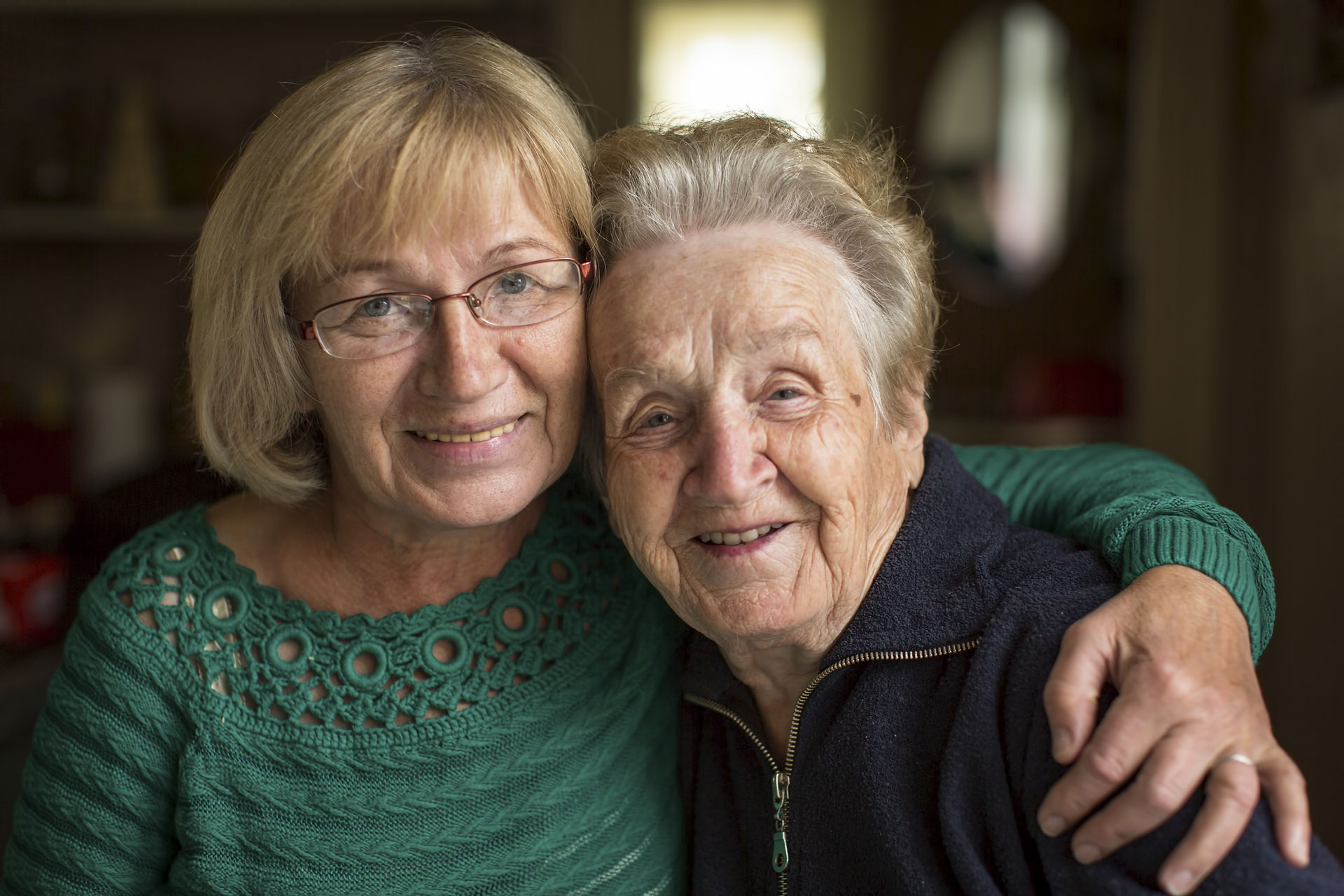 Carer smiling with grandmother
