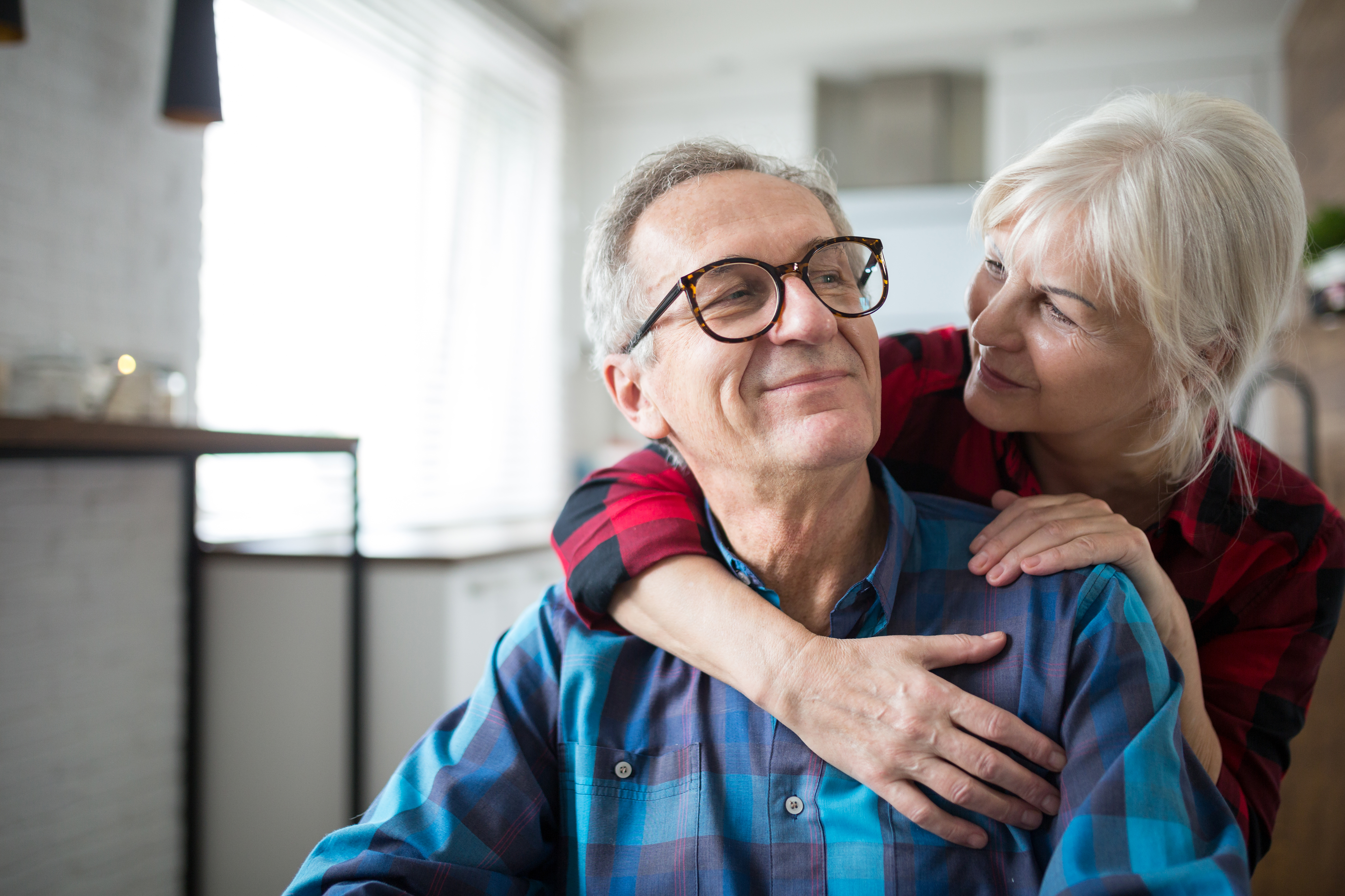 eldery couple embracing each other