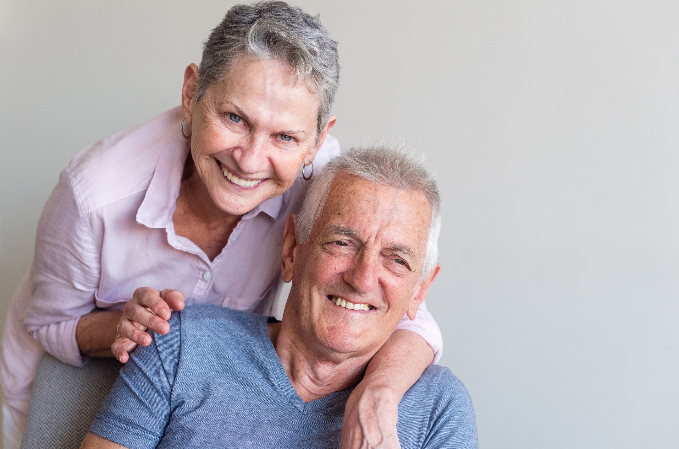 older-couple-smiling-and-looking-happy