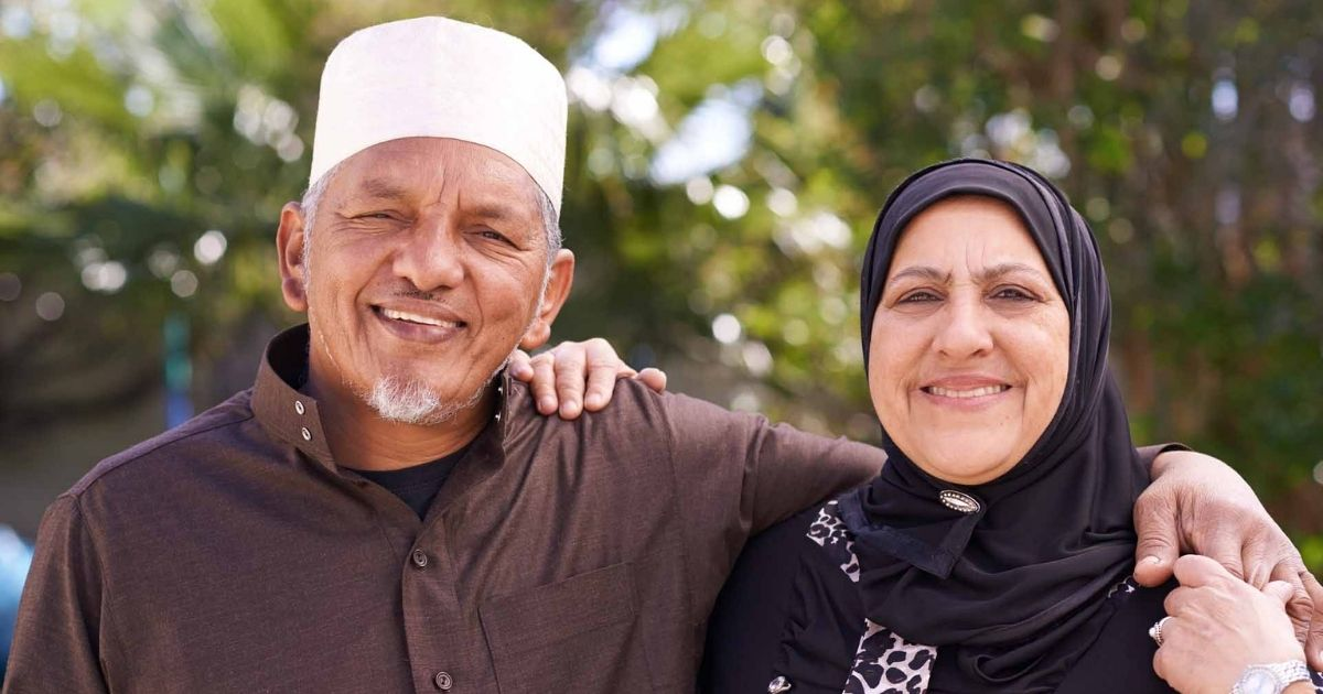 Older Muslim couple looking relaxed.