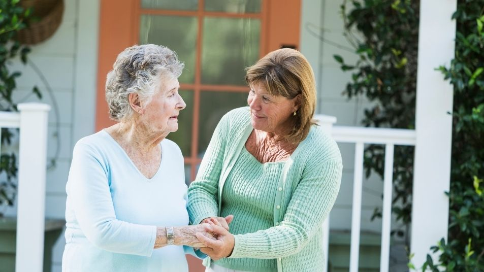 carer helping a woman with her balance