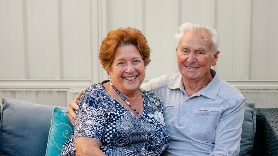 senior couple smiling and looking happy