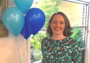 Jeanie Hurrey Advance Care Planning Clinic smiling with balloons